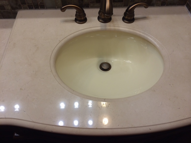 how to get the polish back on my marble vanity countertop